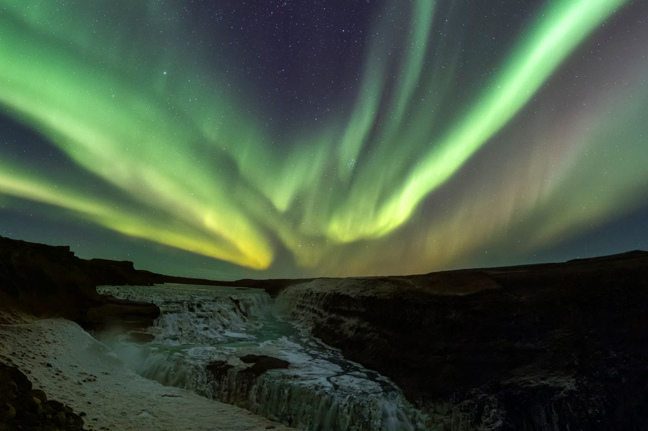 aurora borealis over Gullfoss waterfall